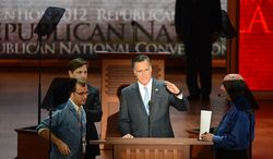 Republican presidential nominee Mitt Romney checks the teleprompter and sound levels with staff members Aug. 30, 2012, at the Republican National Convention at the Tampa Bay Times Forum in Tampa, Fla. (Rod Lamkey, Jr./The Washington Times)