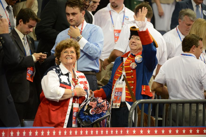 Delegates wave to friends in the crowd at the Republican National Convention at the Tampa Bay Times Forum. (Andrew Harnik/ The Washington Times)