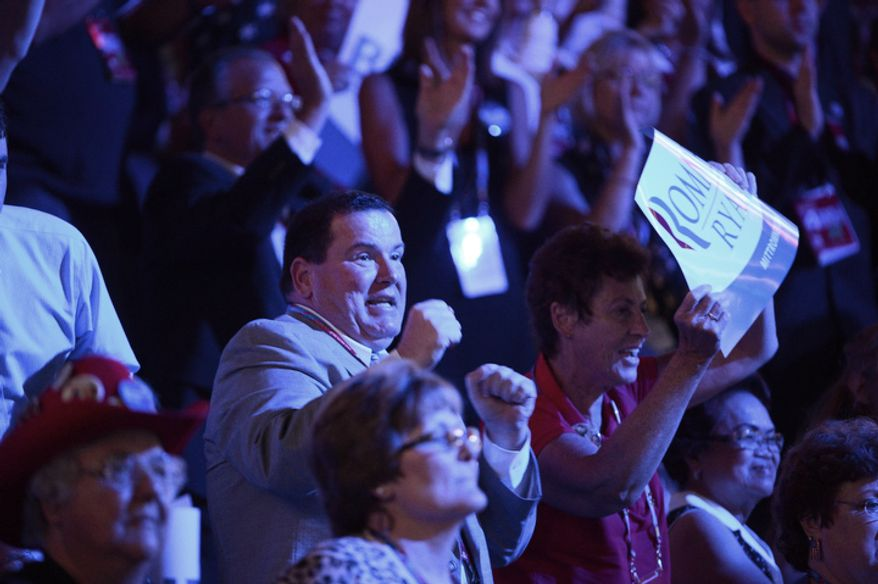 People dance as American Idol contestant Taylor Hicks sings at the Republican National Convention at the Tampa Bay Times Forum in Tampa, Fla. on Thursday, August 30, 2012. (Andrew Harnik/ The Washington Times)