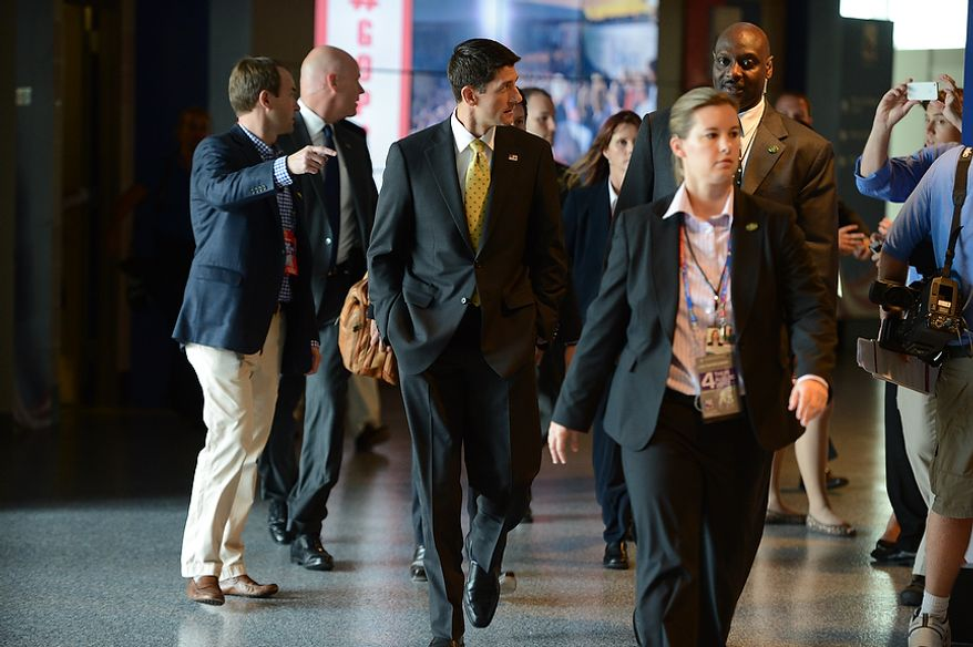 Vice-presidential nominee Rep. Paul Ryan walks to an interview with Wolf Blitzer on CNN at the Republican National Convention at the Tampa Bay Times Forum in Tampa, Fla. on Thursday, August 30, 2012. (Andrew Harnik/ The Washington Times)