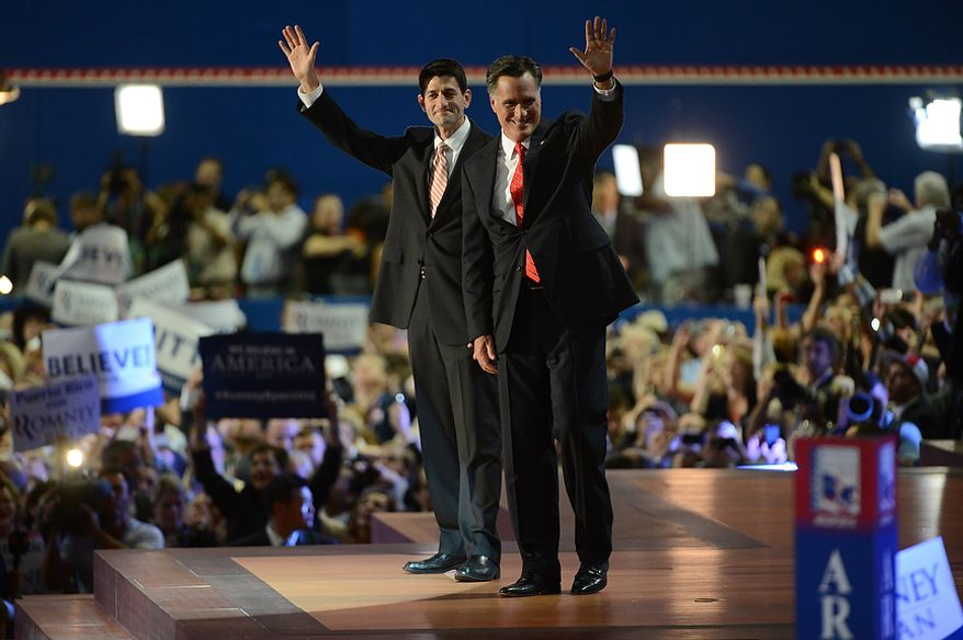 Republican presidential nominee Mitt Romney is joined on stage by his running mate, vice-presidential nominee Rep. Paul Ryan, after Romney accepted the nomination of the Republican Party for President of the United States at the Republican National Convention at the Tampa Bay Times Forum in Tampa, Fla. on Thursday, August 30, 2012.  (Andrew Harnik/ The Washington Times)