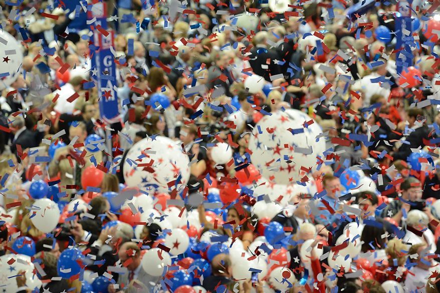 Confetti drops after Mitt Romney accepts the nomination of the Republican Party for President of the United States at the Republican National Convention at the Tampa Bay Times Forum in Tampa, Fla. on Thursday, August 30, 2012. (Rod Lamkey, Jr./ The Washington Times)