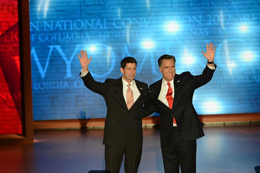 Republican presidential nominee Mitt Romney is joined on stage by his running mate, vice-presidential nominee Rep. Paul Ryan, after Romney accepted the nomination of the Republican Party for President of the United States at the Republican National Convention at the Tampa Bay Times Forum in Tampa, Fla. on Thursday, August 30, 2012. (Rod Lamkey, Jr./ The Washington Times)