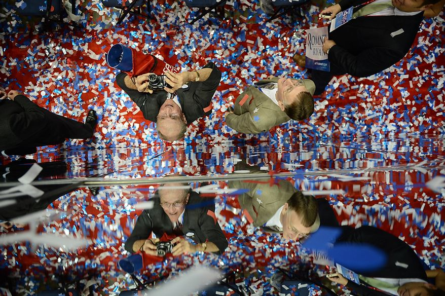 Republicans celebrate after Mitt Romney accepts the nomination of the Republican Party for President of the United States at the Republican National Convention at the Tampa Bay Times Forum in Tampa, Fla. on Thursday, August 30, 2012. (Andrew Harnik/ The Washington Times)
