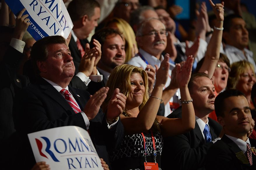 Republicans celebrate after Mitt Romney accepts the nomination of the Republican Party for President of the United States at the Republican National Convention at the Tampa Bay Times Forum in Tampa, Fla. on Thursday, August 30, 2012.(Andrew Harnik/ The Washington Times)