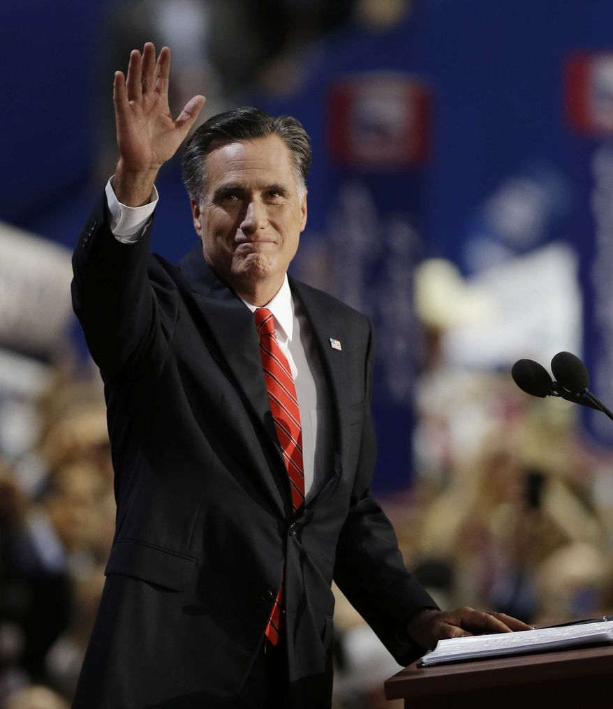 Republican presidential nominee Mitt Romney waves to delegates before speaking at the Republican National Convention in Tampa, Fla., on Thursday, Aug. 30, 2012. (AP Photo/Charlie Neibergall)