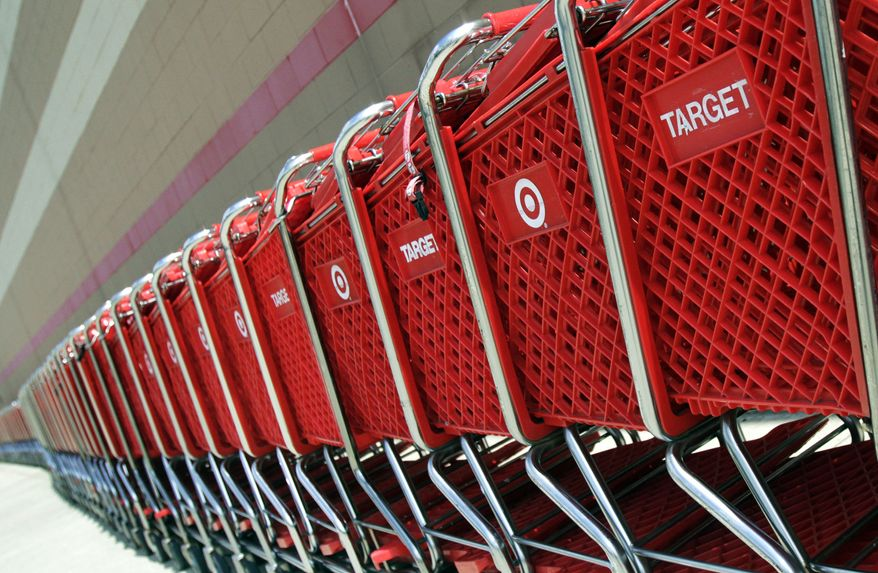 **FILE** Shopping carts sit parked outside a Target store in Marlborough, Mass., on July 28, 2012. (Associated Press)