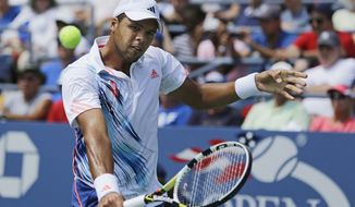 France's Jo-Wilfried Tsonga returns a shot to Slovakia's Karol Beck in the first round of play at the 2012 US Open tennis tournament, Tuesday, Aug. 28, 2012, in New York. (AP Photo/Mike Groll)