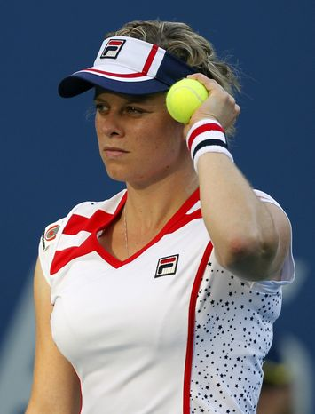 Kim Clijsters of Belgium pauses during her match with Laura Robson of Great Britain in the second round of play at the 2012 US Open tennis tournament,  Wednesday, Aug. 29, 2012, in New York. (AP Photo/Mel C. Evans)