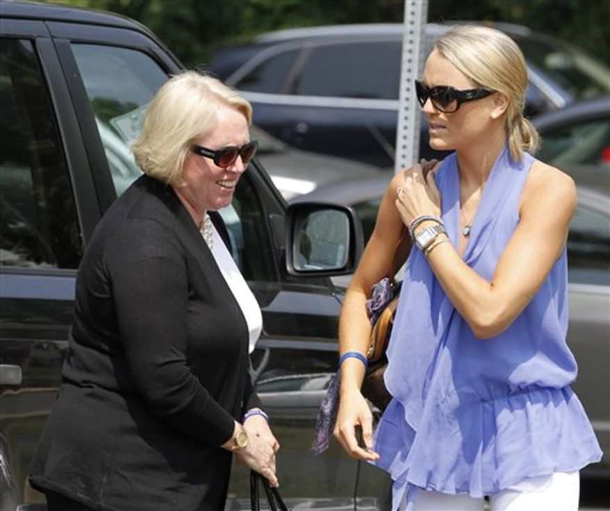 Sharon Love, left, mother of victim Yardley Love, and her daughter, Lexie, arrive at the Charlottesville Circuit courthouse for the sentencing of George Huguely V in Charlottesville, Va., Thursday, Aug. 30, 2012.   Huguely was sentenced to 26 years in prison for the alcohol-fueled beating death of his ex-girlfriend in 2010.  (AP Photo/Steve Helber)