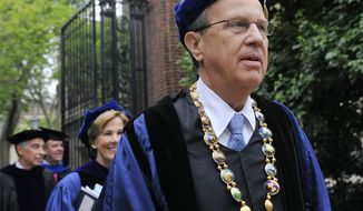 **FILE** Yale University president Richard Levin (right) leads a procession May 21, 2012, during Yale's commencement exercises in New Haven, Conn. (Associated Press)