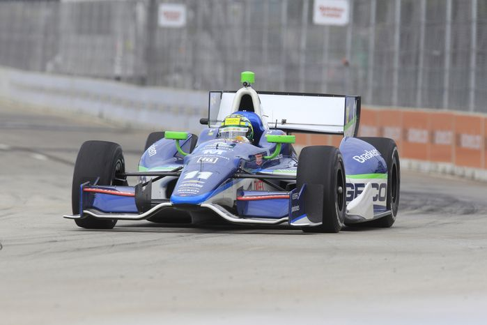 IndyCar driver Tony Kanaan of Brazil drives during the IndyCar practice on Belle Isle in Detroit, Saturday, June 2, 2012. (AP Photo/Carlos Osorio)