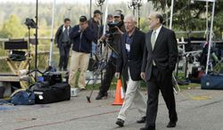 ** FILE ** Federal Reserve Chairman Ben Bernanke (right) and Bank of Israel Governor Stanley Fischer walk together Aug. 31, 2012, past television cameras outside of the Jackson Hole Economic Symposium at Grand Teton National Park near Jackson Hole, Wyo. (Associated Press)