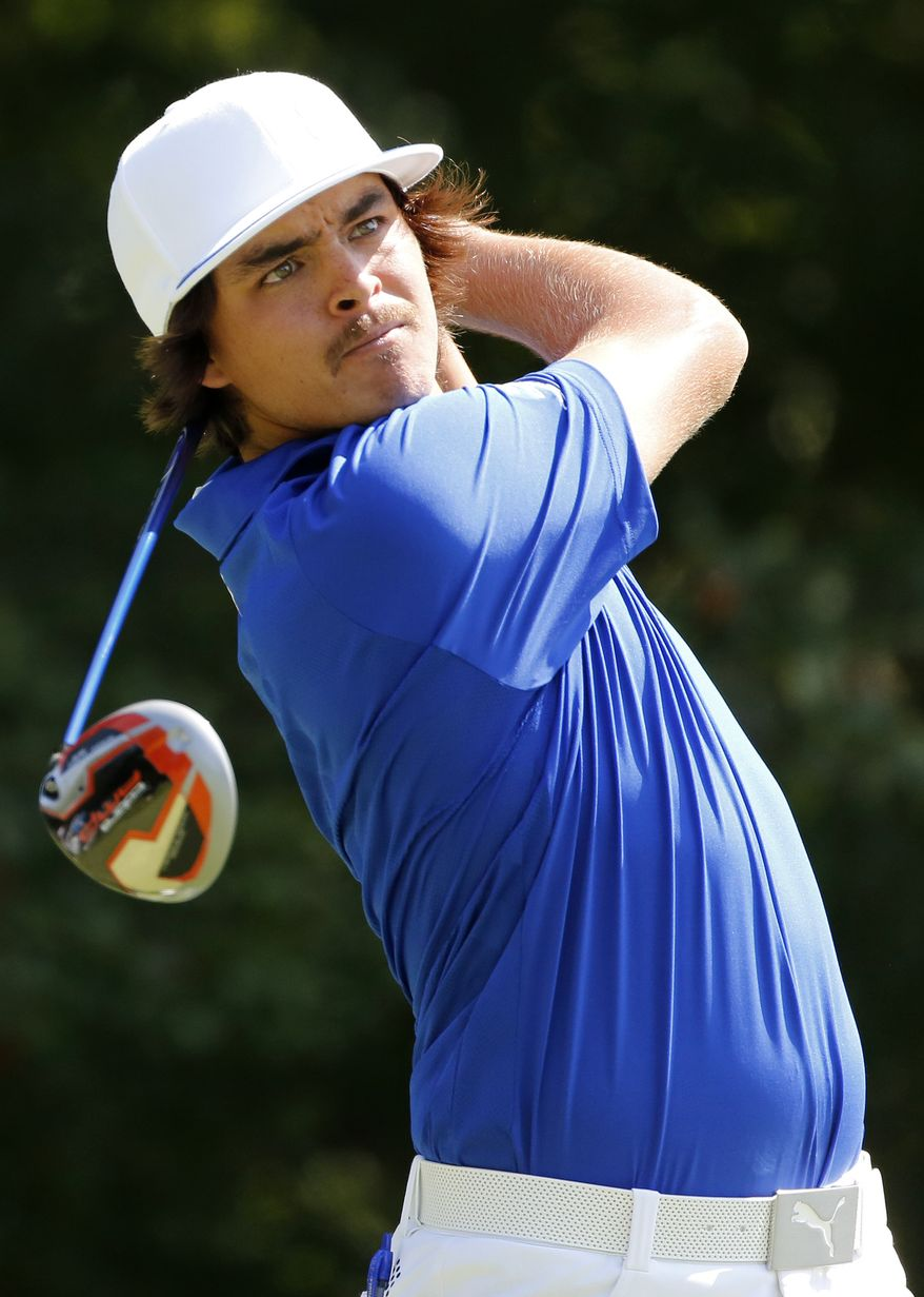 Rickie Fowler tees off on the fourth hole during the Pro Am round of the Deutsche Bank Championship golf tournament at TPC Boston in Norton, Mass., Thursday, Aug. 30, 2012. (AP Photo/Michael Dwyer)