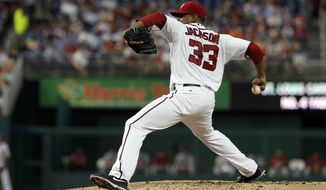 Washington Nationals starting pitcher Edwin Jackson (33) throws during a baseball game with the St. Louis Cardinals at Nationals Park, Thursday, Aug. 30, 2012, in Washington. The Nationals won 8-1. (AP Photo/Alex Brandon)