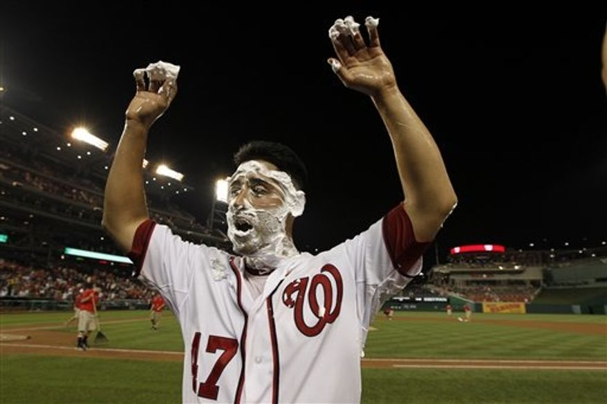 Washington Nationals starting pitcher Gio Gonzalez cheers with shaving cream on his face after pitching a complete game shutout in a baseball game against the St. Louis Cardinals at Nationals Park Friday, Aug. 31, 2012, in Washington. The Nationals won 10-0. (AP Photo/Alex Brandon)