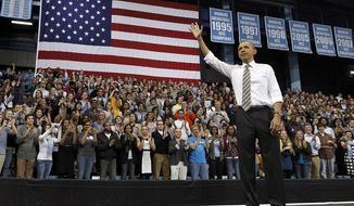 ** FILE ** In this April 24, 2012, file photo President Barack Obama acknowledges the crowd after speaking at the University of North Carolina in Chapel Hill, N.C. (AP Photo/The News & Observer, Chuck Liddy, Pool)