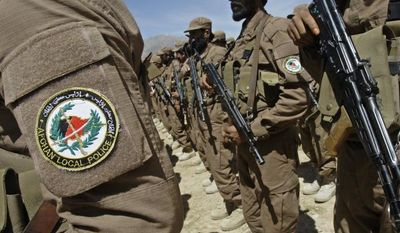 ** FILE ** Members of the Afghan Local Police (ALP) listen to a speech during a ceremony presenting new uniforms for the ALP at Gizab village of Uruzgan province, southwest of Kabul, Afghanistan, on Sunday, April 24, 2011. (AP Photo/Kamran Jebreili)