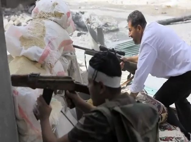 In this image made from video and accessed on Saturday, Sept. 1, 2012, Free Syrian Army fighters engage with government troops in Aleppo, Syria. (AP Photo via AP Video)
