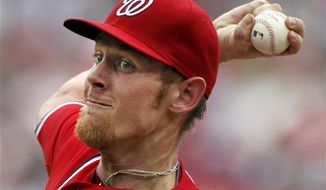 Washington Nationals starting pitcher Stephen Strasburg throws during the second inning of a baseball game with the St. Louis Cardinals at Nationals Park, Sunday, Sept. 2, 2012, in Washington. The Nats beat St. Louis 4-3. (AP Photo/Alex Brandon)