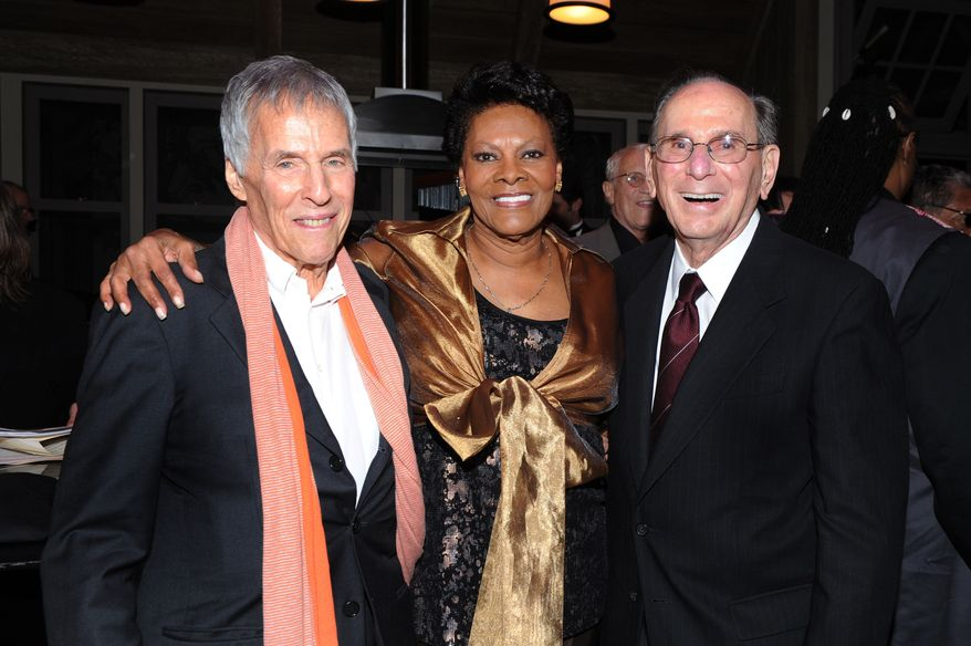 "Composer Bert Bacharach (left) and lyricist Hal David (right) pose with singer Dionne Warwick, their longtime collaborator, at the ""Love, Sweet Love"" musical tribute to Mr. David on his 90th birthday in Los Angeles in October 2011. (AP Photo/Vince Bucci)"