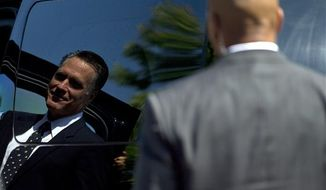 Secret Service agents stand guard as Republican presidential nominee, former Massachusetts Gov. Mitt Romney walks to his car after services at the Church of Jesus Christ of Latter-day Saints on Sunday, Sept. 2, 2012 in Wolfeboro, N.H. (AP Photo/Evan Vucci)