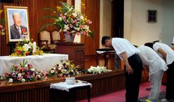 Followers pay their respects to the Rev. Sun Myung Moon at a Unification Church in Tokyo on Monday, Sept. 3, 2012. Rev. Moon died Monday, Sept. 3, 2012, at a church-owned hospital near his home in Gapyeong County, northeast of Seoul, church officials said. He was 92. (AP Photo/Koji Sasahara)
