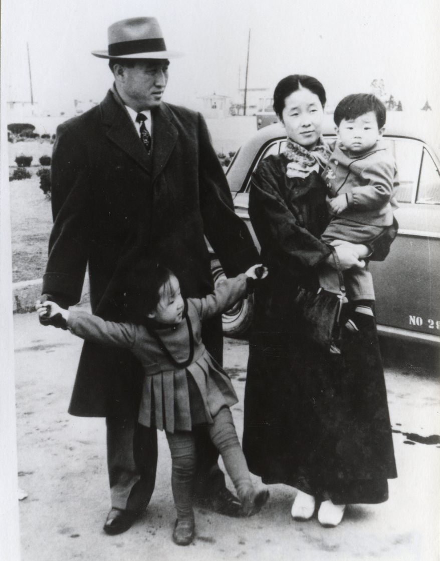 The Rev. Sun Myung Moon with his wife, Hak Ja Han Moon, whom he married in 1960 when she was 17, pose with son Hyo Jin and daughter Ye Jin in mid-1960s. (HSA-UWC photographs)