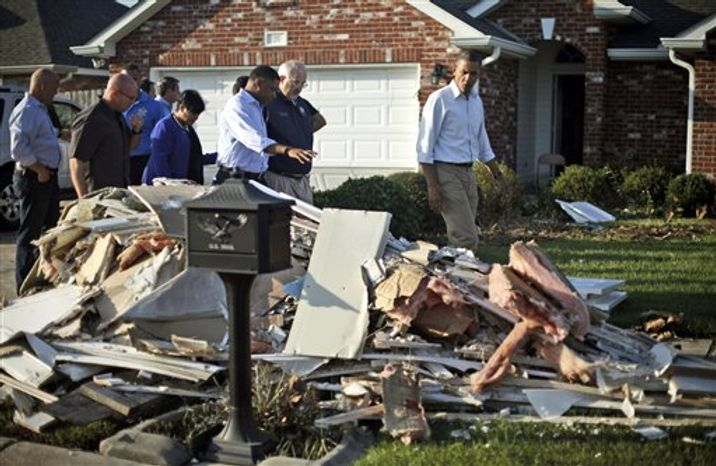 President Obama walks past debris on the sidewalks as he tours the Bridgewood neighborhood in LaPlace, La., in the Saint John the Baptist Parish, with local officials to survey the ongoing response and recovery efforts to Hurricane Isaac, Monday, Sept. 3, 2012. (AP Photo/Pablo Martinez Mon