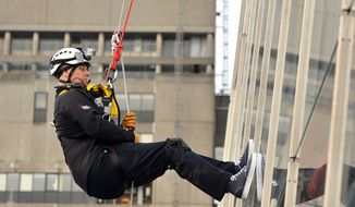 Britain's Prince Andrew abseils down the Shard, the tallest building in Europe, in central London on Monday, Sept. 3, 2012. (AP Photo/PA Wire, Max Nash)