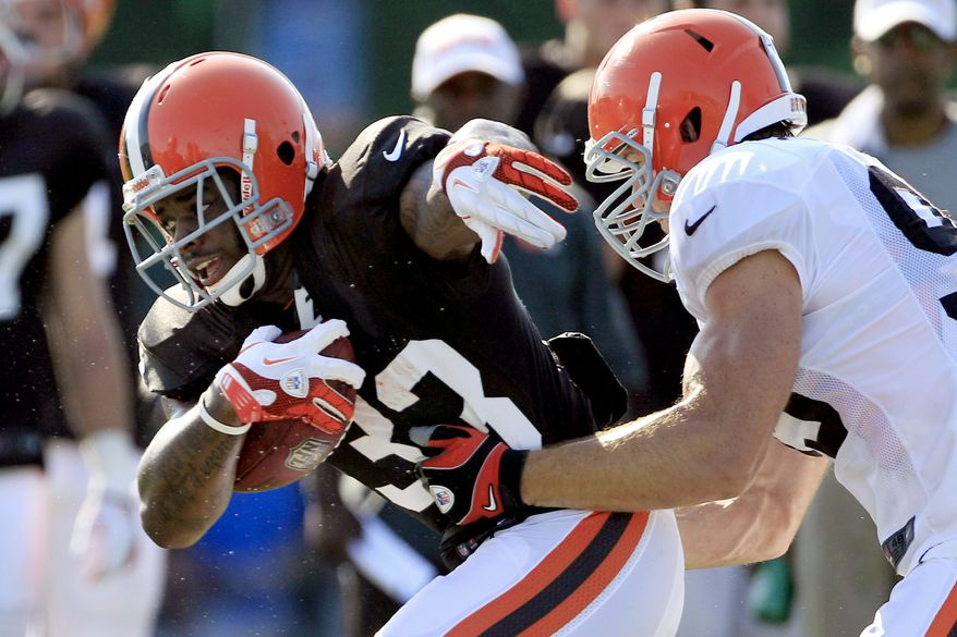 FILE - In this July 29, 2012, file photo, Cleveland Browns running back Trent Richardson, left, tries to get past linebacker Scott Fujita during NFL football training camp  in Berea, Ohio. Coming off a dismal 4-12 season, their eighth in nine years of at least 10 losses, the Browns enter 2012 with high hopes and low expectations. The Browns are scheduled to begin their regular season on Sept. 9 at home against the Philadelphia Eagles. (AP Photo/Tony Dejak, File)