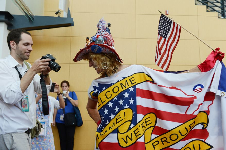 "Mississippi delegate and volunteer for the Obama campaign, Kelly Jacobs, who calls herself ""The Mistress of Enthusiasm"" has her photograph taken at the Charlotte Convention Center. (Barbara Salisbury/ The Washington Times)"