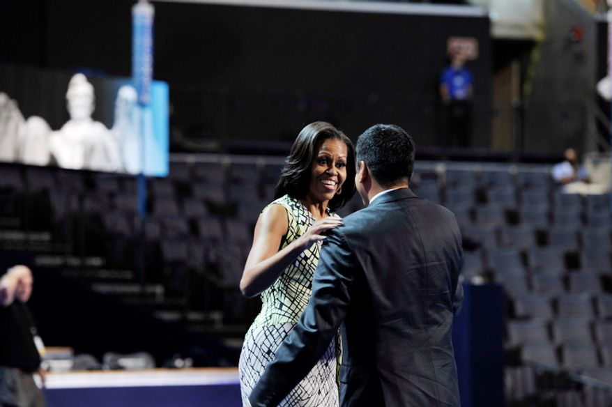 The First Lady of The United States, Michelle Obama welcomes Kal Penn on the stage to film a campaign video during the Democratic National Convention. (Barbara Salisbury/ The Washington Times)