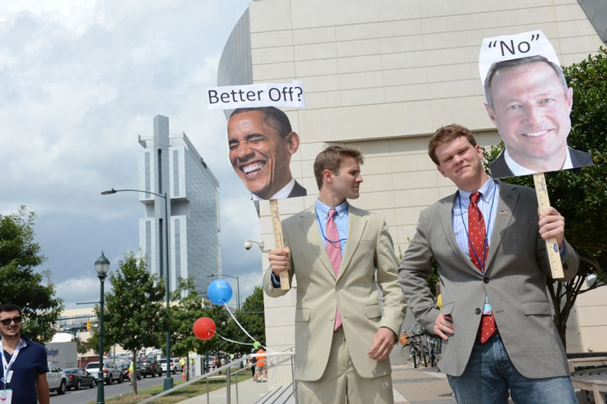 """Two men who would not give their names but described themselves as """"Republican college students who are dissatisfied with their government"""" protest outside the Democratic National Convention. (Barbara Salisbury/ The Washington Times)"""