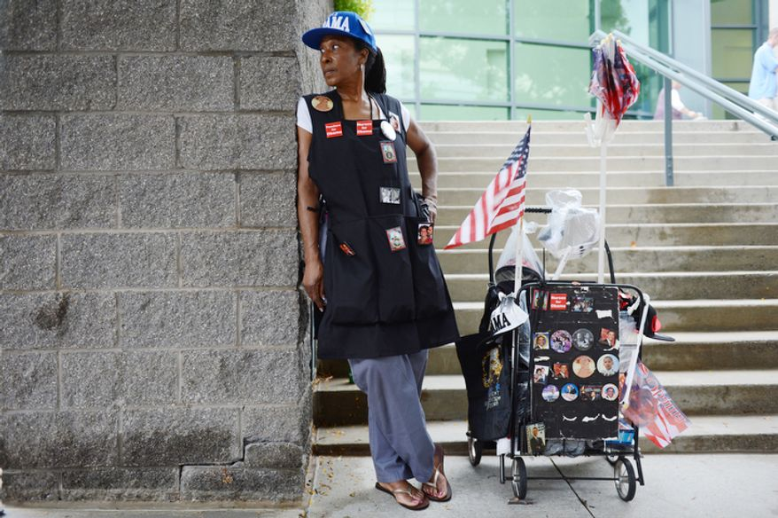 Claudia Blakemore, a registered nurse from Houston, Tex., drove to Charlotte, N.C. to sell Obama commemorative items during the convention. She said she bought a lot of the items for the last Democratic convention and is able to sell things relatively cheaply because she bought in bulk--some 10,000 buttons, for example. (Barbara L. Salisbury/The Washington Times)