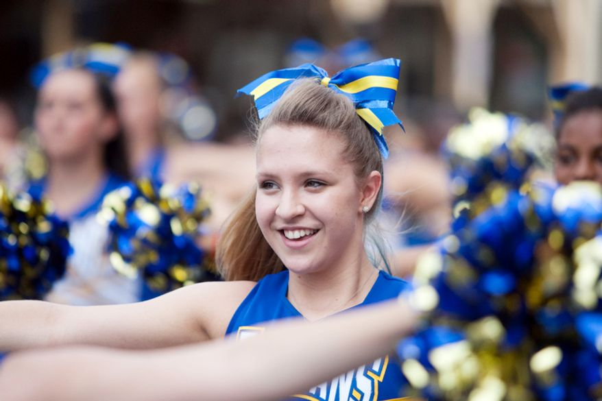 Gaithersburg High School cheerleaders perform while in the Gaithersburg end-of-summer festivity.  (Craig Bisacre/The Washington Times)