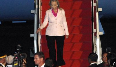 Secretary of State Hillary Rodham Clinton arrives at the Halim Perdanakusuma Airport in Jakarta, Indonesia, on Monday, Sept. 3, 2012, for a two-day visit. (AP Photo/Tatan Syuflana)