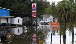 Floodwaters from Hurricane Isaac inundate structures in Scaresdale, La., on Sunday, Sept. 2, 2012. (AP Photo/Gerald Herbert)