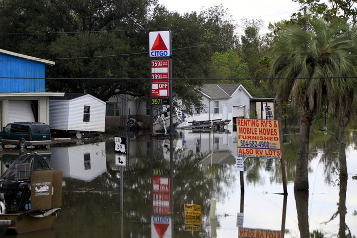 Floodwaters from Hurricane Isaac inundate structures in Scaresdale, La., on Sunday,