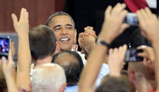 President Obama shakes hands with supporters after speaking at a campaign event at Scott High School Monday, Sept. 3, 2012, in Toledo, Ohio. (AP Photo/Tony Dejak)