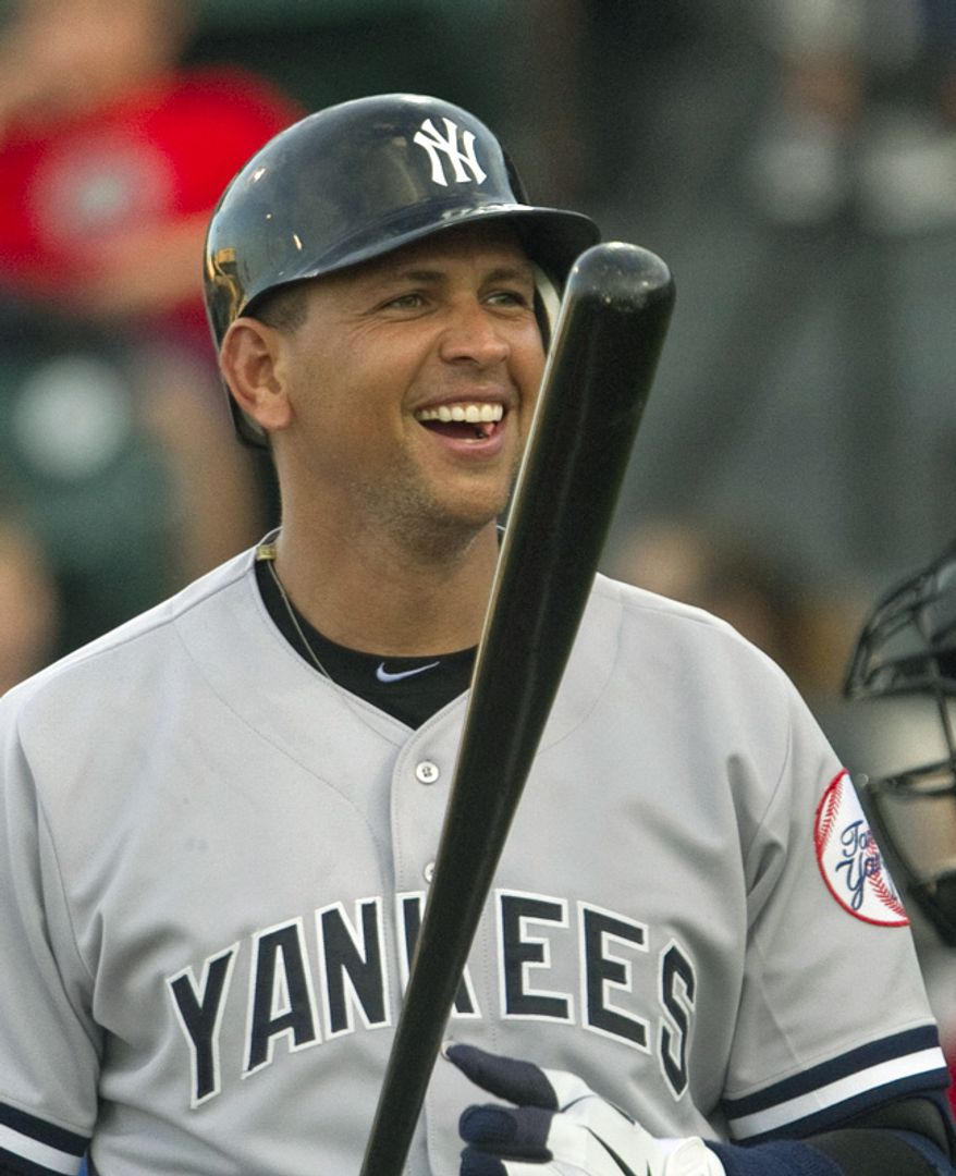 New York Yankees third baseman Alex Rodriguez smiles during his at bat in his rehab start for the Tampa Yankees in the first inning of a minor league baseball game against the Lakeland Flying Tigers at Joker Marchant Stadium on Friday, Aug. 31, 2012, in Lakeland, Fla. Rodriguez made his first plate appearance since going on the disabled list on July 25 with a fractured left hand. (AP Photo/The Lakeland Ledger, Michael Wilson) TAMPA TRIBUNE OUT