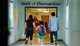 Parents take their children to their classrooms on the first day back to school at North Springfield Elementary School, Springfield, Va., Tuesday, September 4, 2012. (Andrew Harnik/The Washington Times)