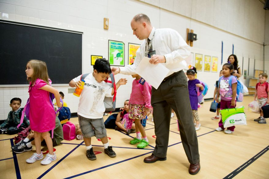 Principal Chad McRae gets students ready to head to class on the first day back to school at North Springfield Elementary School, Springfield, Va., Tuesday, September 4, 2012. (Andrew Harnik/The Washington Times)
