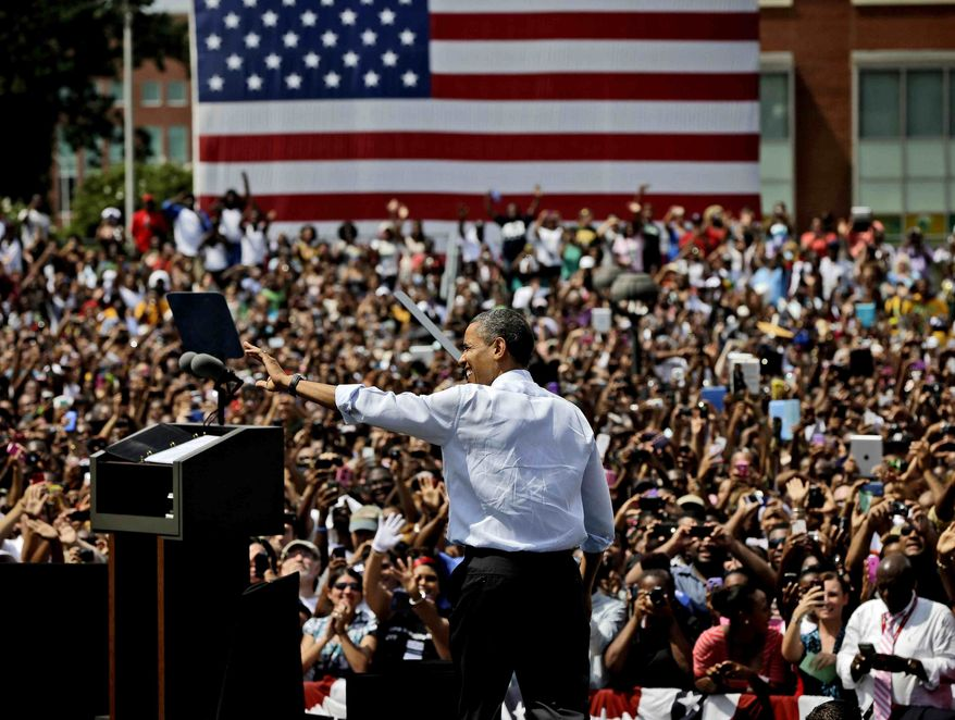President Obama waves to supporters Sept. 4, 2012, as he takes the stage for a campaign event at Norfolk State University in Norfolk, Va. (Associated Press)