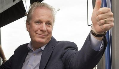 Quebec Premier Jean Charest, the leader of the Quebec Liberal Party, salutes supporters as he campaigns at a riding office in Montreal on Tuesday, Sept. 4, 2012. (AP Photo/Canadian Press, Ryan Remiorz)