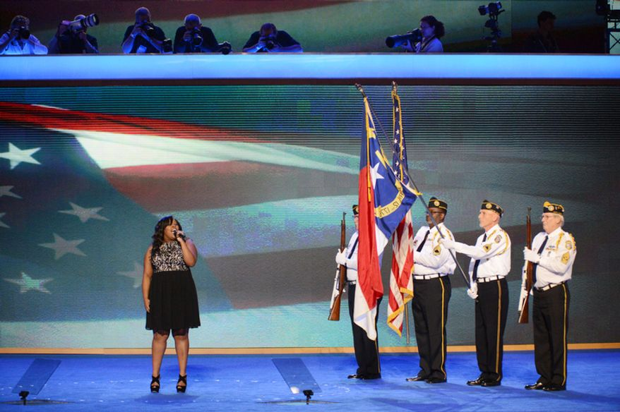 """Amber Riley, singer/songwriter and """"Glee"""" actress, sings the National anthem before a color guard of Disabled American Veterans of The Stanly County Chapter 12 Honor Guard the Democratic National Convention. (Andrew Geraci/ The Washington Times)"""