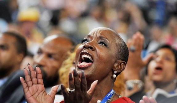 North carolina delegate Denise Adams applauds as Cory A. Booker-D, Mayor of Newark, N.J. addresses the Democratic National Convention. (Barbara Salisbury/ The Washington Times)