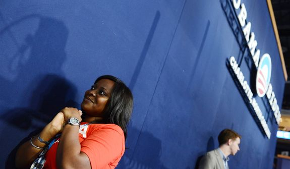 Texas delegate Trisha Frederick, of Houston, Tex., listens to speeches at the Democratic National Convention. (Barbara Salisbury/ The Washington Times)