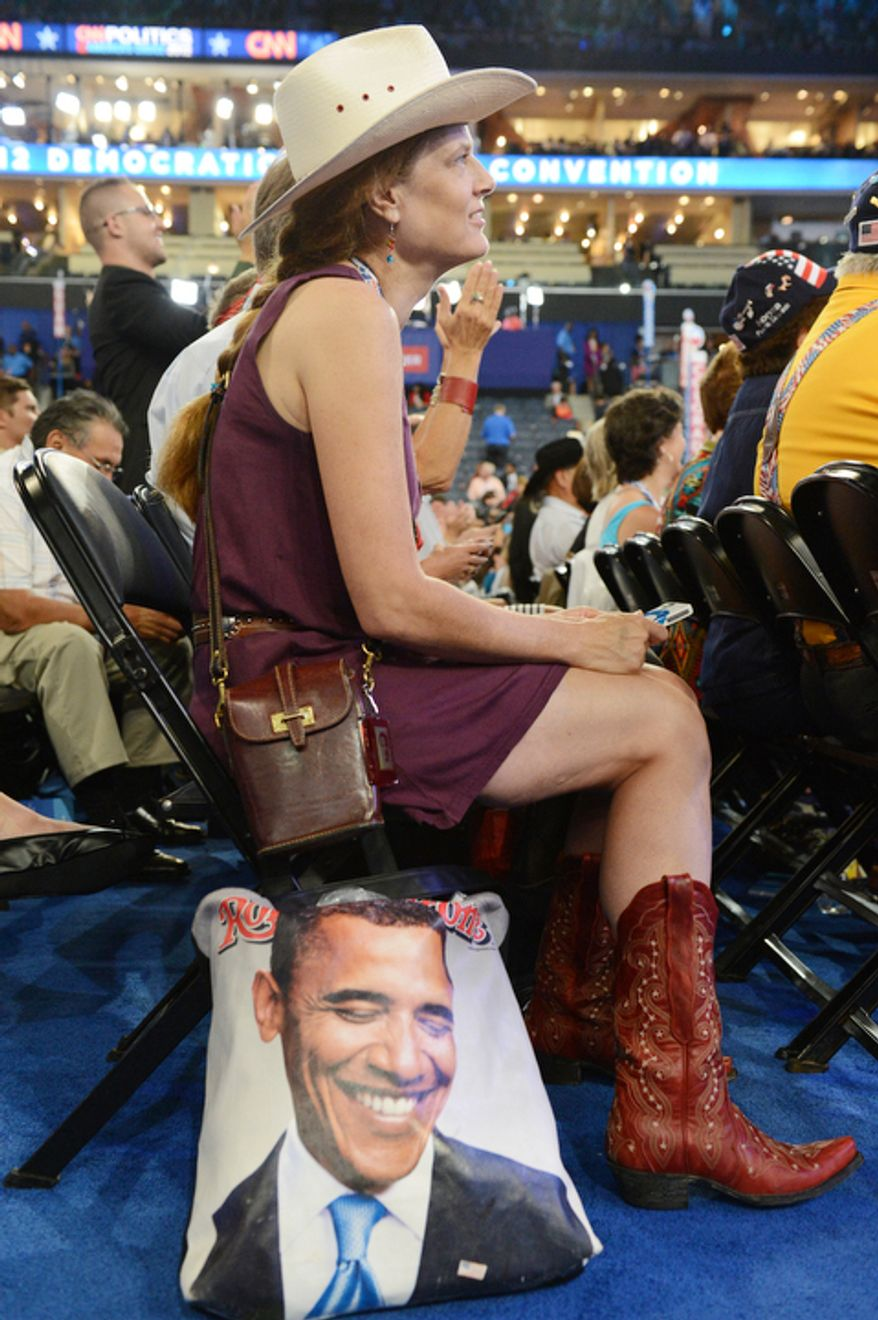 Colorado delegate Tracy Ducharme, of Colorado Springs, Colo., watches speeches on the opening night of the Democratic National Convention. (Barbara Salisbury/ The Washington Times)