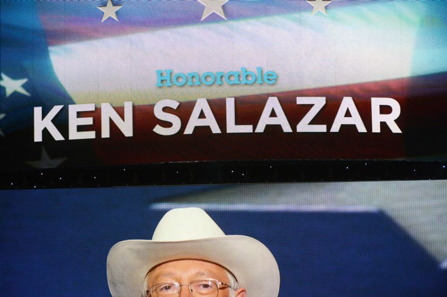 Ken Salazar, Secretary of the Interior, is seen on the large screen above the stage. (Andrew Geraci/ The Washington Times)